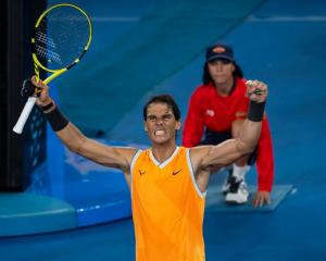 Rafael Nadal celebrates his quarterfinal win at the Australian Open. Photo: Getty Images