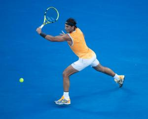 Rafael Nadal plays a backhand during his semifinal win at the Australian Open. Photo: Getty Images