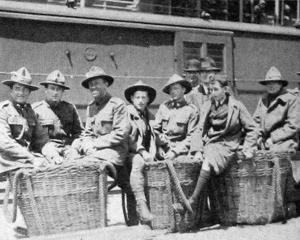 Soldiers who returned by the Tahiti wait at the quayside with their luggage. - Otago Witness, 22...