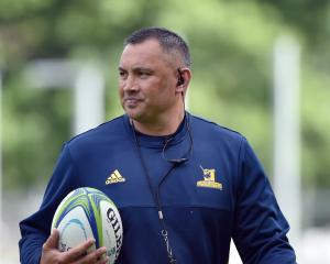 New Highlanders skills coach Riki Flutey casts his eye over the setup at training at Logan Park...