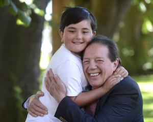 Sir Tim Shadbolt and his son Declan (6) celebrate the news of his knighthood in Invercargill last...