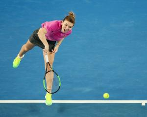 Simona Halep in action during her first round Australian Open match. Photo: Getty Images