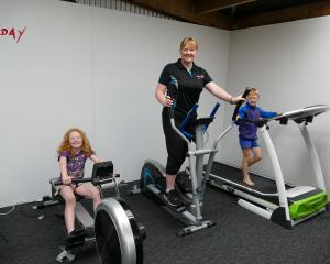 Otaitai farmer and personal trainer Louisa Willis works out with her children Tera (9) and Axel ...