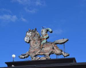 The broken neon horse-and-rider sign atop Dunedin's Meridian mall. Photo: Shawn McAvinue
