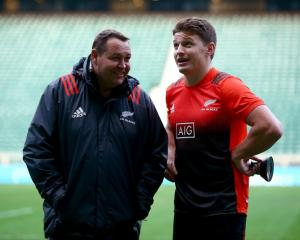 Steve Hansen (left) talks with Beauden Barrett at Twickenham at the end of last year. Photo:...