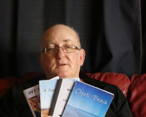 Invercargill poet Terry Lynch with some of his published books of poetry. Mr Lynch uses his...