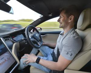 Rockertwerkz founder Dean Hall enjoys a handsfree moment in his Tesla. Photo: ODT files