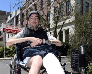 Hit-and-run victim Tim Patrick outside Dunedin Hospital. Photo: Stephen Jaquiery