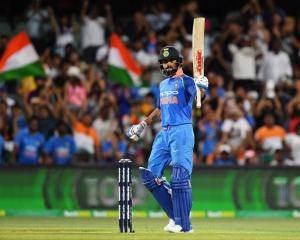 Virat Kohli celebrates his century during India's win last night. Photo: Getty Images