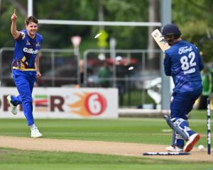Otago bowler Jacob Duffy enjoys removing two of Auckland opening batsman Colin Munro's stumps at...