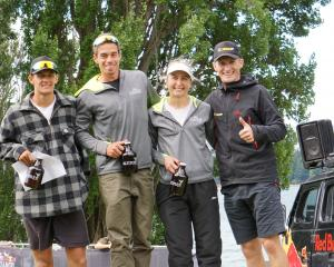 The champions of the inaugural four-person Red Bull Defiance event standing atop the podium are,...