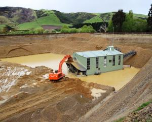 Waikaia Gold's 42m dredge, fed by an 85-tonne excavator, working at a depth of around 16m at the...