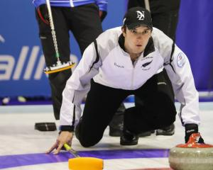 New Zealand skip Matthew Neilson competes during the win over Italy in the final in Lohja,...