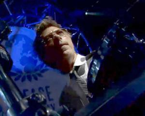 John Mahon, who plays percussion in Elton John's band, keeps time during a 2010 show. Photo:...