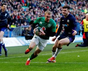 Ireland's Keith Earls runs in to score against Scotland. Photo: Reuters