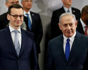 Poland's Prime Minister Mateusz Morawiecki and Israel's Prime Minister Benjamin Netanyahu look on...