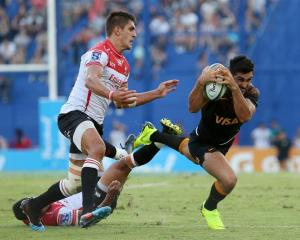 Jaguares captain Jeronimo de la Fuente falls with the ball against the Lions. Photo: Reuters