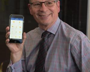 University of Otago information services director Mike Harte uses the new Otago App, helping...