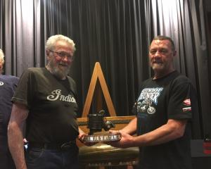 John Munro (left) presents the prestigious Spirit of Burt Munro award to Alexandra motorbike...