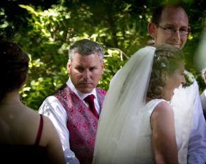 Paul Wilson (left) as groomsman to David Bain and Liz Davies during their wedding in 2014. Photo:...