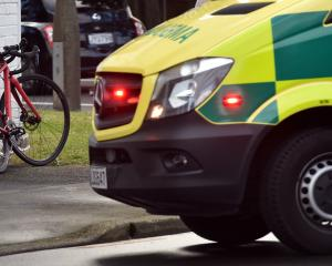 Ambulance and police at an accident between a vehicle and cyclist on corner of Hanover St and...