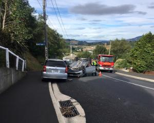 The car rolled on Kenmure Rd in Dunedin on Sunday morning. Photo: Peter McIntosh