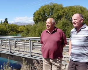 Inspecting the aging Albert Town bridge is (left) Albert Town resident Bruce Hebbard and Albert...