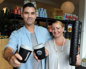 Nick Maguire, of the Kind Grocer, and Steph Fry, of IdealCup, show the first of the cups to be...