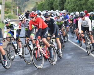 The elite men tackle the first corner at the start of a Calder Stewart Cycling Series race at...