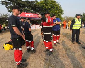 Emergency response team get ready to head out as forest fires continue to burn across the Tasman...