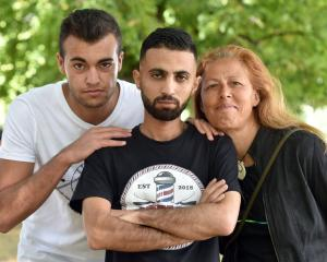 Syrian former refugee Mohammad Saad Aldeen (centre) with his friends Naser Tamimi (left) and Jane...