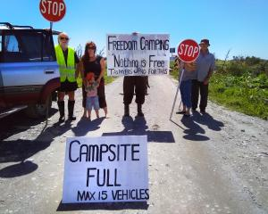 Kakapotahi and Pukekura residents picket the Beach Rd camp, at Waitaha, as they take action to...