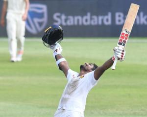 Sri Lanka's Kusal Perera celebrates the victory. Photo: Getty