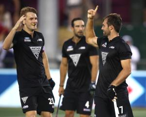 Nic Woods (right),  of New Zealand (right) celebrates his goal from a penalty corner during the...