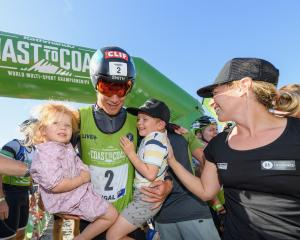 Wanaka athlete Dougal Allan celebrates with his children Flynn (4) and Matilda (2) and wife Amy...
