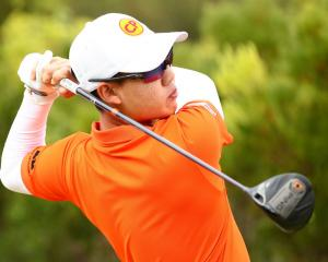 Jazz Janewattananond, of Thailand, hits a tee shot during the Vic Open at 13th Beach Golf Club in...