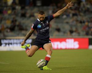 Quade Cooper steps in for a conversion attempt for the Rebels against the Brumbies. Photo: Getty