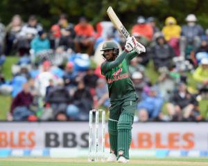 Mohammad Mithun plays a shot on his way to a half-century for Bangladesh against New Zealand in...