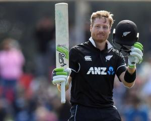 Martin Guptill celebrates his century. Photo / Getty