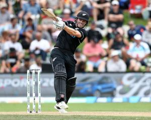 Henry Nicholls hits out on his way to 64 against Bangladesh in Dunedin. Photo: Getty