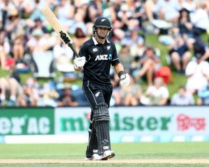 Ross Taylor celebrates reaching his half-century against Bangladesh at the University of Otago...
