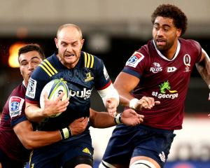 Matt Faddes of the Highlanders is tackled during the Round 2 Super Rugby match between the Otago...