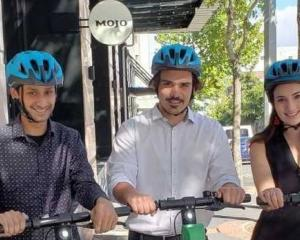Helloworld staff Kalpesh Tailor (left), Jake Sunde and Molly Foster with new helmets. Photo:...