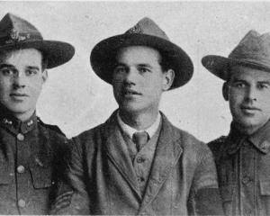 Three brothers from Lawrence who met recently in London. From left: Gunner R. L. Anderson, 14th...