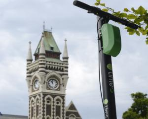 A Lime scooter parked opposite the University of Otago Registry Building. Photo: Gerard O'Brien
