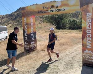 Alps 2 Ocean Ultra race director Mike Sandri greets Paul Hewitson as he crosses the 45km stage...