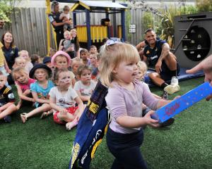 Highlanders halfback Aaron Smith watches the distribution skills of Lillie Porthouse (2) as she...