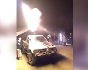 Flamethrower ignited and blasted at Dystopia festival. / Cory Sykes