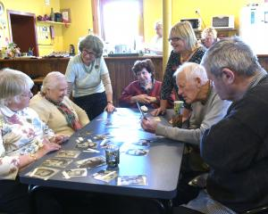 Playing a memory game at the Senior-Link activity centre are Daisy Madden, Karin Madsen, co...