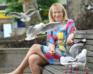 Dunedin resident Sophie Barker with threatened red-billed gulls, in Dunedin's Octagon. Photo:...